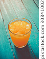 top view orange juice in glass with ice on ocean  30841002