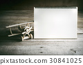 wood toy airplane with blank notebook on wood 30841025