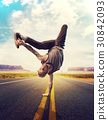 Young male hip hop dancer posing on a road 30842093