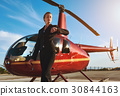 Business woman near the helicopter 30844163