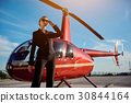 Business woman near the helicopter 30844164