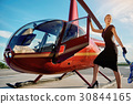 Business woman near the helicopter 30844165
