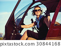 Attractive woman pilot 30844168