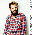 portrait of young bearded hipster guy smiling on 30856132
