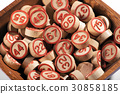 Bowl of lucky round wooden bingo numbers 30858185