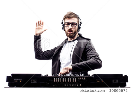 Trendy male dj posing against mixing console 30866672