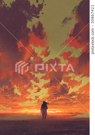 lonely man looking at fiery sunset sky 30867421