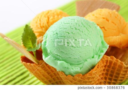 Ice cream in waffle basket 30868376