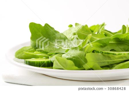 Rocket and cucumber salad 30868428