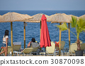 parasol and sunbed on the beach 30870098