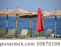 parasol and sunbed on the beach 30870106