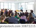 Speaker giving presentation on business conference 30872215