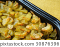 Large group of baked potatoes 30876396