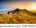 Group of tourist enjoy hiking on the top mountain 30876664