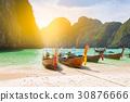 Traditional long tail boat docking in Maya bay 30876666