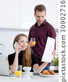 Businesswoman working at home drinking coffee 30902716