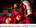 The snake leaned over the table to poison apple 30907154