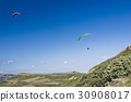 Paragliding in blue cloudy sky 30908017