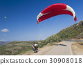 Paragliding in blue cloudy sky 30908018