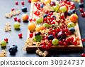 Assortment of fresh berries on cutting board. 30924737