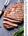 Grilled beef steak Slate stone table. Top view 30924787