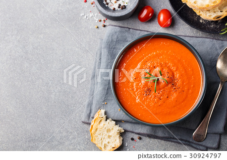 Tomato soup in a black bowl. Top view. Copy space. 30924797