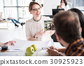 Hilarious smiling woman in office 30925923