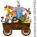 Many wild animals on wooden wagon 30929482