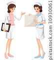 Two nurses in blue and pink uniform 30930061