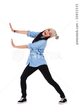 Woman pushing something imaginary over white 30931535