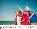 Family of superheroes on the beach. Summer vacation concept 30934273