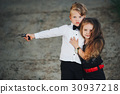 young boy and girl playing spy 30937218