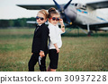 young boy and girl playing spy 30937228