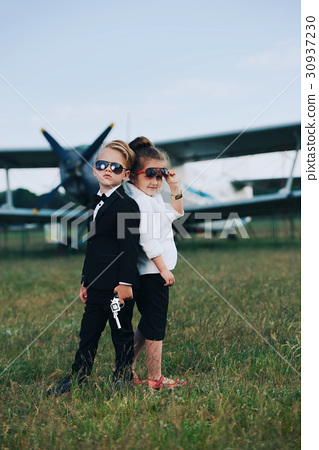 young boy and girl playing spy 30937230