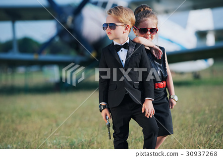 young boy and girl playing spy 30937268