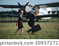 young boy and girl playing spy 30937272
