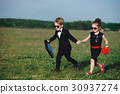 young boy and girl playing spy 30937274