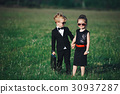 young boy and girl playing spy 30937287