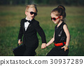 young boy and girl playing spy 30937289