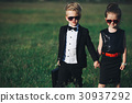 young boy and girl playing spy 30937292