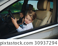 little boy driving car with girlfriend 30937294