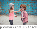 photo of two cute hipsters 30937320