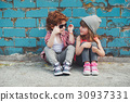 photo of two cute hipsters 30937331