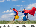 Father and son playing superhero at the day time. 30938809