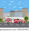 Fire truck on road in urban landscape 30939465