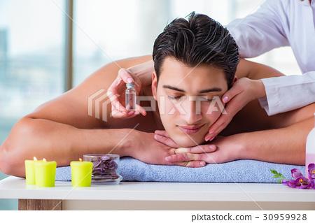Handsome man in spa massage concept - ภาพถ่ายสต็อก [30959928