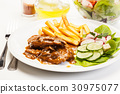 Pork chop with sauce, mushrooms and chips 30975077