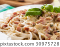 Spaghetti carbonara with bacon and basil 30975728