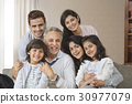 Portrait of smiling multi-generation family 30977079