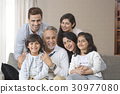 Portrait of smiling multi-generation family on sofa 30977080